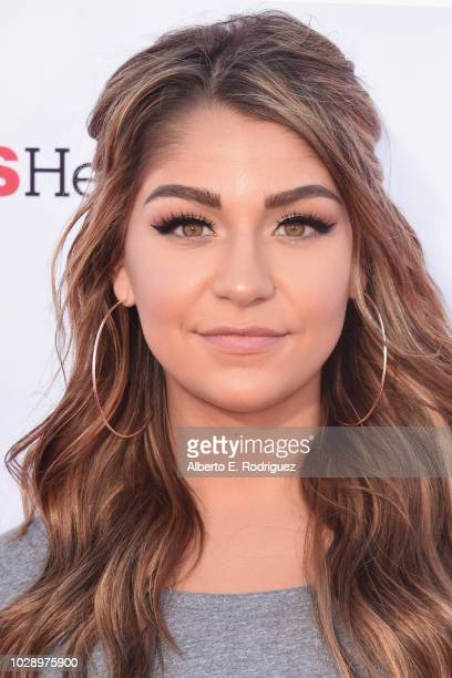 Andrea Russett attends the sixth biennial Stand Up To Cancer telecast at the Barkar Hangar on Friday September 7 2018 in Santa Monica California