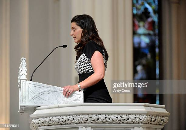 Andrea Sandoval Reed offers a prayer at the funeral mass for her father former Colorado State Senator Paul Sandoval at the Cathedral Basilica of the...