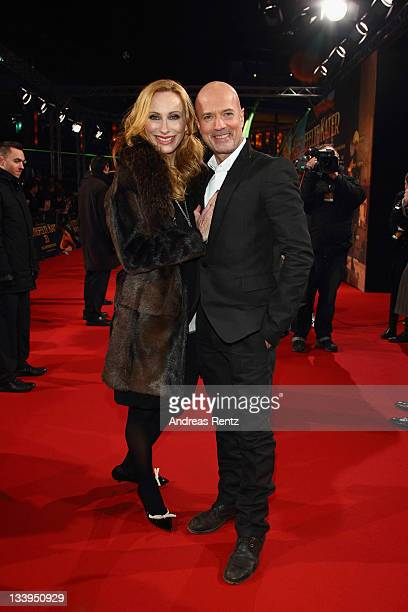 Andrea Sawatzki and Christian Berkel attend the German Premiere 'Der Gestiefelte Kater' at CineStar on November 22 2011 in Berlin Germany
