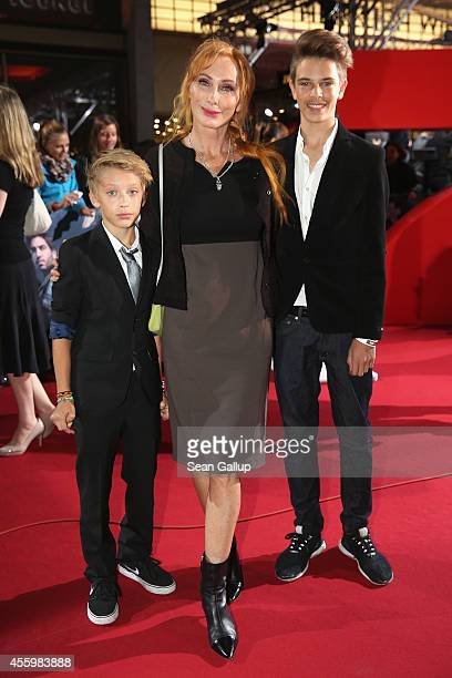 Andrea Sawatzki and her sons Bruno and Moritz attend the premiere of the film 'Who am I' at Zoo Palast on September 23 2014 in Berlin Germany