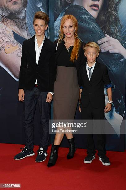 Andrea Sawatzki and her sons Bruno and Moritz attends the premiere of the film 'Who am I' at Zoo Palast on September 23 2014 in Berlin Germany