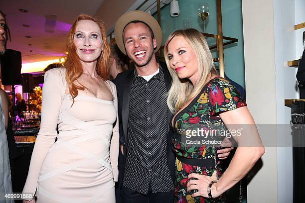 Andrea Sawatzki Marlon Roudette and Regina Halmich during the 50th Anniversary of AIGNER on April 16 2015 in Munich Germany