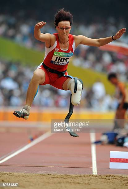 Andrea Scherney of Austria on her way to winning the final of the women's long jump F44 clasification event at the 2008 Beijing Paralympic Games in...