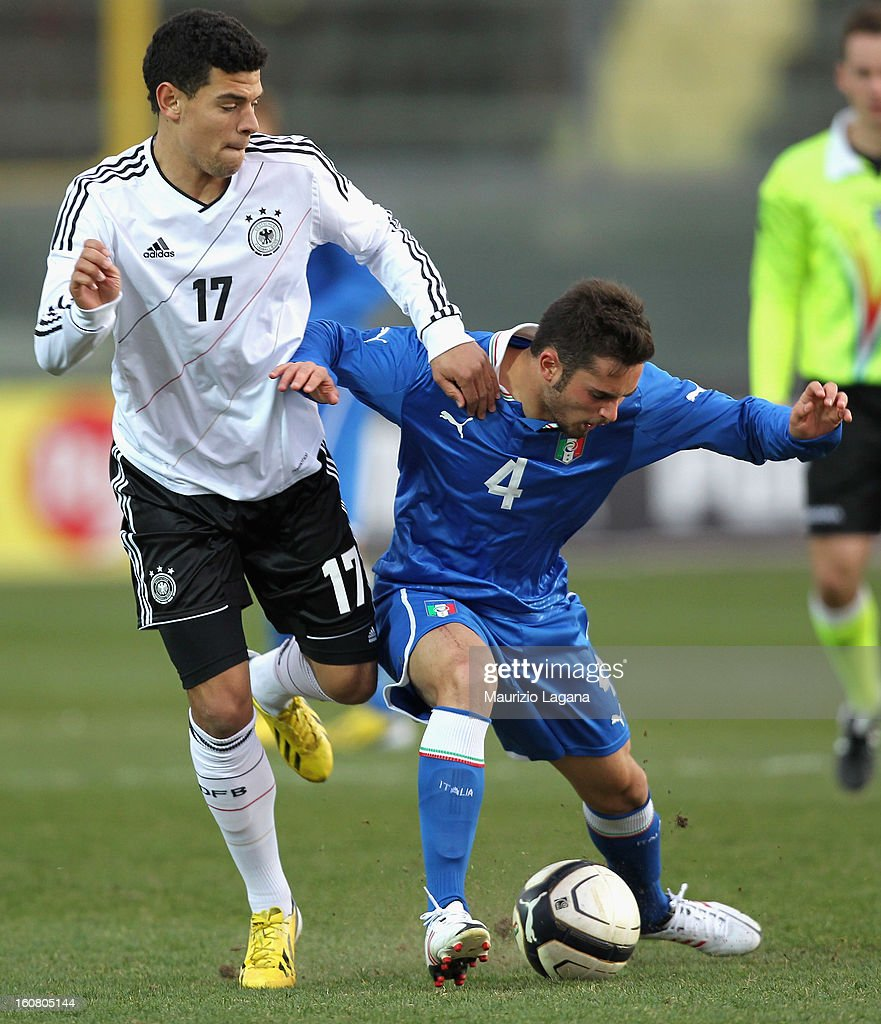 Andrea Schiavone (R) of Italy competes for the ball with Shawn Parker of Germany during U20 International Friendly match between Italy and Germany at Stadio Cosimo Puttilli on February 6, 2013 in Barletta, Italy.