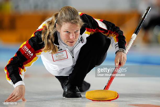 Andrea Schopp of Germany reacts after she releases the stone in the match between USA and Germany during Day 2 of the Titlis Glacier Mountain World...
