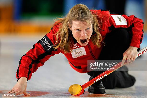 Andrea Schopp of Germany screams to her team mates after she releases the stone in the match between Japan and Germany during Day 3 of the Titlis...