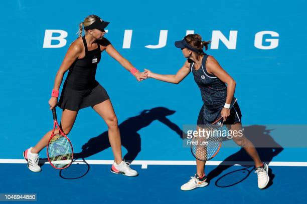 Andrea Sestini Hlavackova and Barbora Strycova of Czech Republic celebrate against Gabriela Dabrowski of Canada and Xu Yifan of China during their...
