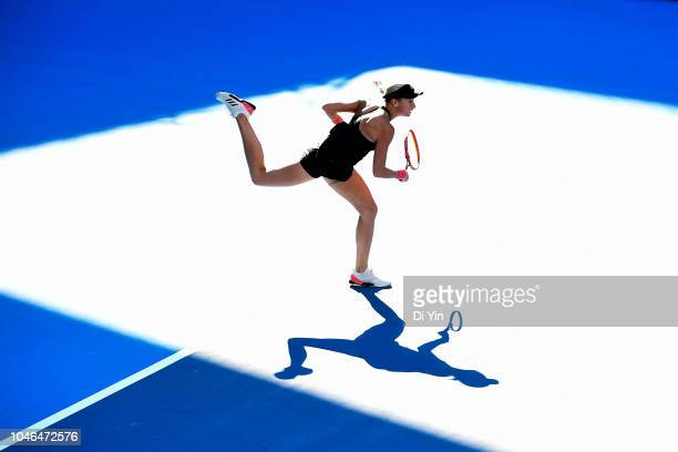 Andrea Sestini Hlavackova of Czech Republic serves to Elise Mertens of Belgium and Demi Schuurs of the Netherlands with her teammate Barbora Strycova...