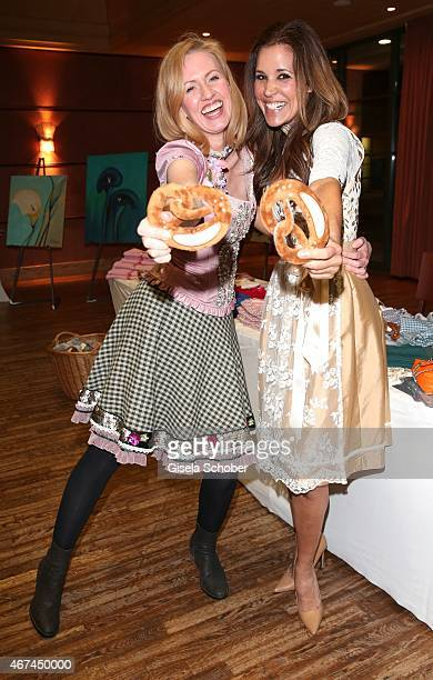 Andrea Sokol Karen Webb during the SIXT fashion dinner at Nockherberg on March 24 2015 in Munich Germany