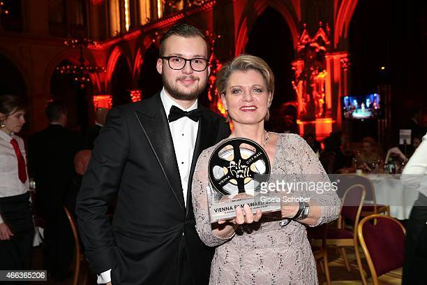 Andrea Spatzek with her son Alexander Spatzek and award during the Filmball Vienna 2015 on March 14 2015 in Vienna Austria