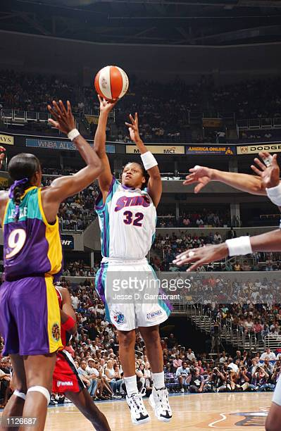 Andrea Stinson of the Eastern Conference All Stars attempts a shot over Lisa Leslie of the Western Conference AllStars during the 2002 WNBA All Game...