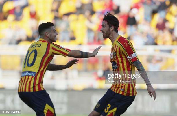 Andrea Tabanelli of Lecce celebrates after scoring his team's equalizing goal with hia teammate Filippo Falco during the Serie A match between US...
