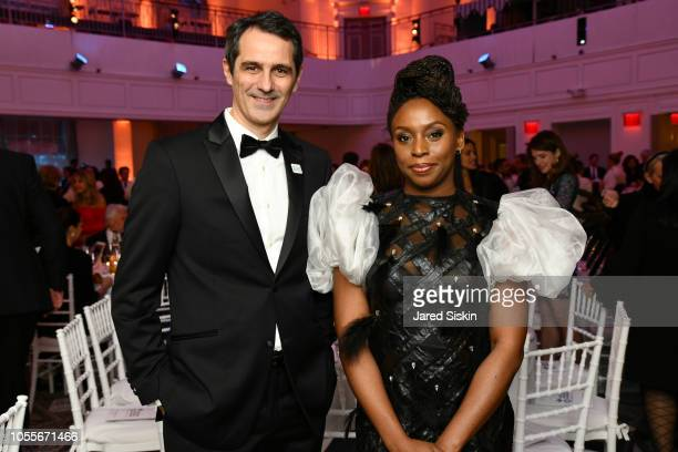 Andrea Tamburini and Chimamanda Adichie attend the 2018 Action Against Hunger Gala at 583 Park Avenue on October 30 2018 in New York City