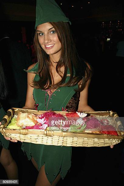 Andrea Tiede is one of the four models passing out gifts of his and hers bracelets on June 5 2004 in Las Vegas Nevada