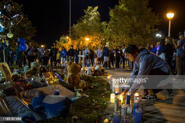 Andrea Tovar lights up a candle at a vigil held for shooting victims on November 17 2019 in Santa Clarita California Nathaniel T Berhow a 16...