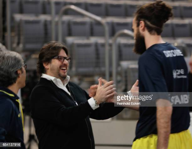 Andrea Trinchieri Head Coach of Brose Bamberg welcomes Luigi Datome #70 of Fenerbahce Istanbul before the 2016/2017 Turkish Airlines EuroLeague...