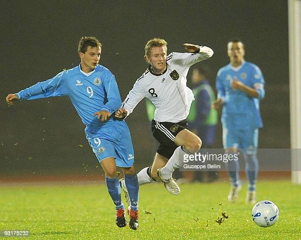 Andrea Venerucci of San Marino and Andre Schuerle of Germany in action during the UEFA Under 21 Championship match between San Marino and Germany at...