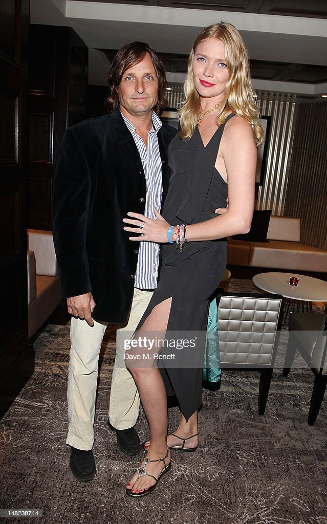 Andrea Vianini and Jodie Kidd poses at Hippodrome Casino Launch Party, Leicester Square, on July 12, 2012 in London, England.