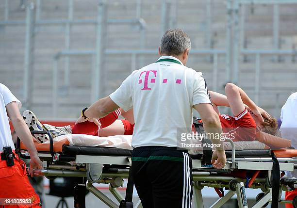 Andrea Viehl of Muenchen must leave the pitch injured during the girls bjunior final match between FC Bayern Muenchen and 1FFC Turbine Potsdam at...