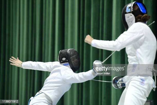 Andrea Vittoria Rizzi of St John's competes against Anne Cebula of Columbia during the Division I Women's Fencing Championship held at The Wolstein...
