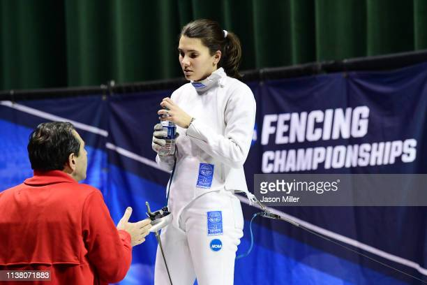 Andrea Vittoria Rizzi of St John's talks to her coach during a timeout against Anne Cebula of Columbia during the Division I Women's Fencing...