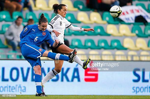 Andrea Vrabcova of Slovakia competes for the ball with Fatmire Bajramaj of Germany during the FIFA Women's World Cup 2015 Qualifier between Slovakia...