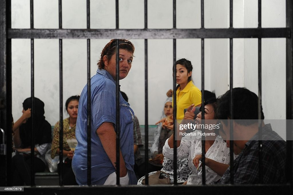 Andrea Waldeck of Britain (43) waits in a women's prison cell for a hearing over drug trafficking charges on January 6, 2014 in Surabaya, Indonesia. Prosecutors are seeking a 16-year prison term and a fine of around £100,000 for Andrea Waldeck, who has admitted trafficking crystal meth into the country from China and previously faced the possibility of a death sentence. The former PCSO with Gloucestershire Police had pleaded guilty to the offence after being arrested in April in possession of 3lb of methamphetamine crystals hidden in her underwear.