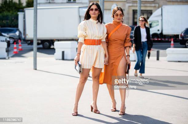 Andrea Wazen wearing yellow belted striped button shirt Karen Wazen is seen wearing orange dress outside Acne during Paris Fashion Week Haute Couture...