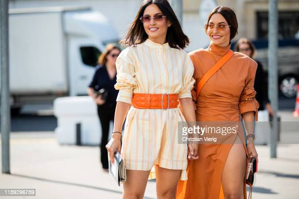 Andrea Wazen wearing yellow belted striped button shirt Karen Wazen is seen wearing orange dress outside Acne during Paris Fashion Week - Haute...