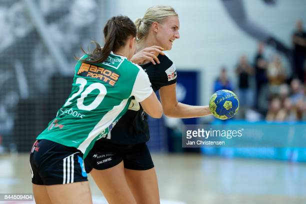 Andrea West Bendtsen of Silkeborg Voel and Kelly Dulfer of Copenhagen Handball challenge for the ball during the Danish HTH Go Ligaen match between...