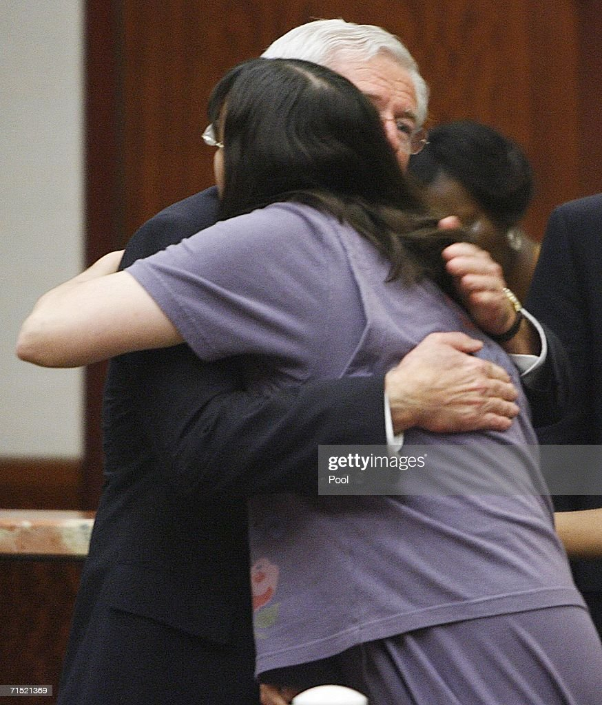 Andrea Yates (R) is hugged by her attorney George Parnham after she was found not guilty by reason of insanity in her retrial July 26, 2006 in Houston. Yates admitted to drowning her five children in a bath tub in 2001 and pleaded guilty by reason of insanity.