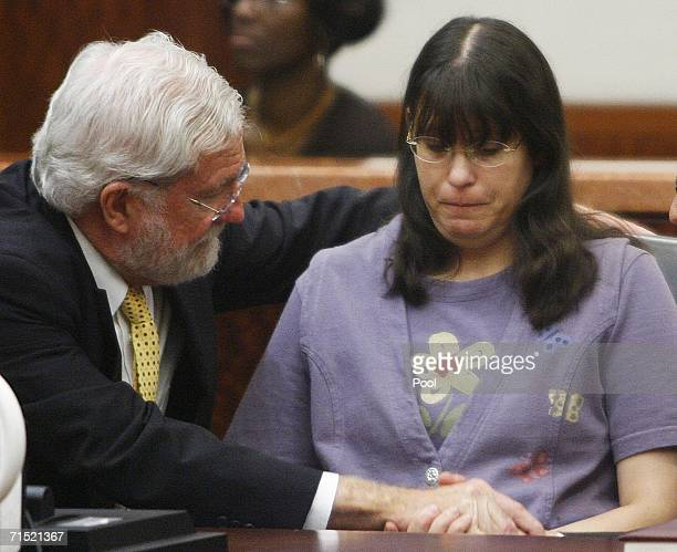 Andrea Yates sits with her attorney George Parnham after the not guilty by reason of insanity verdict was read in her retrial July 26 2006 in Houston...