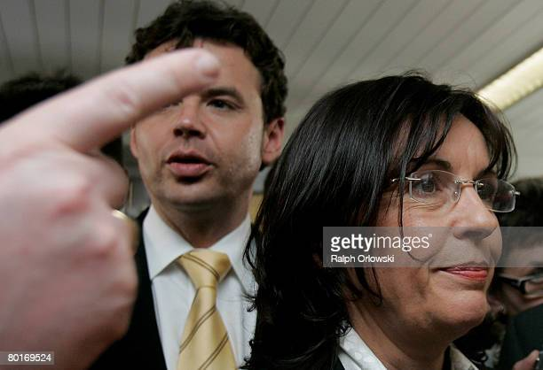 Andrea Ypsilanti Chairwoman of the Social Democratic Party Hesse and her deputy Juergen Walther arrive for a news conference during a party meeting...