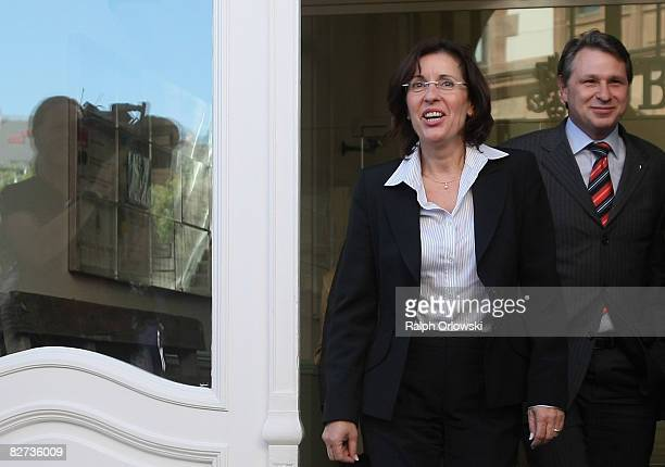 Andrea Ypsilanti chairwoman of the Social Democratic Party of the Geman state of Hesse and general secretary Norbert Schmitt arrive for a statement...