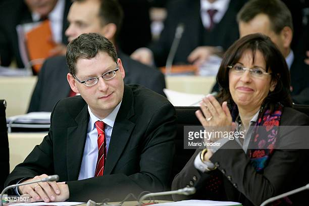 Andrea Ypsilanti head of the Social Democrats of the state of Hesse and the new candidate for governor Thorsten SchaeferGuembel look on at the state...