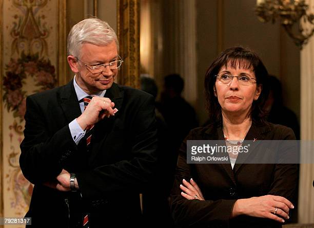 Andrea Ypsilanti top candidate of the Social Democratic Party and Roland Koch Governor of the German state of Hesse attend a television debate during...