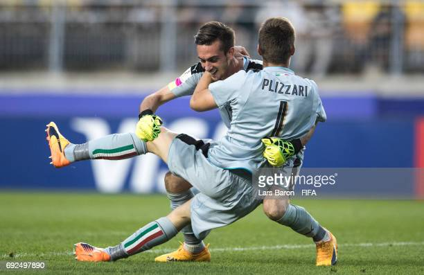 Andrea Zaccagno of Italy celebrates with team mate Alessandro Plizzari of Italy after winning the FIFA U20 World Cup Korea Republic 2017 Quarter...