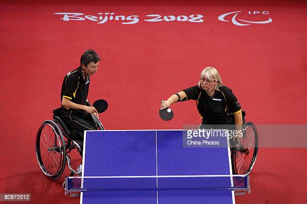 Andrea Zimmerer and Monika Sikora Weinmann of Germany compete in the Women's Team Class 4/5 Table Tennis match between Andrea Zimmerer Monika Sikora...
