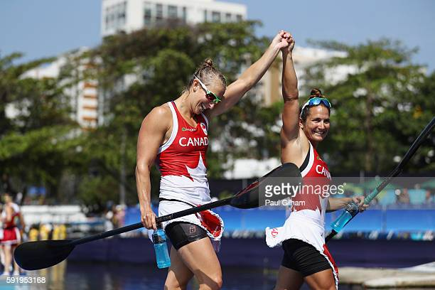 Andreanne Langlois Emilie Fournel Genevieve Orton and Kc Fraser of Canada celebrate after the Women's Kayak Four 500m Semifinal on Day 14 of the Rio...