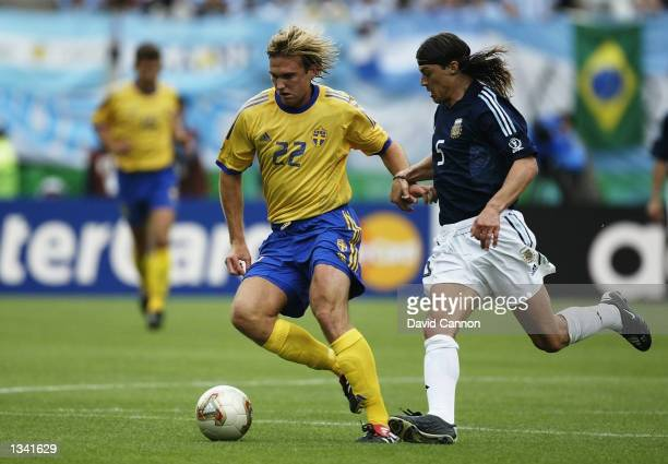 Andreas Andersson of Sweden shields the ball from Matias Almeyda of Argentina during the Group F match of the World Cup Group Stage played at the...