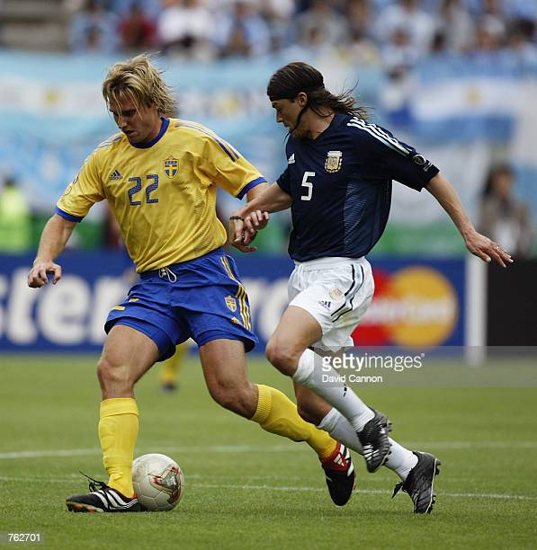 Andreas Andersson of Sweden takes the ball past Matias Almeyda of Argentina during the FIFA World Cup Finals 2002 Group F match played at the Miyagi...