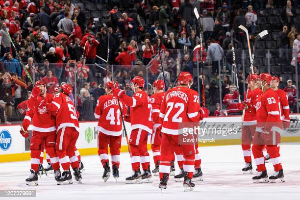 Andreas Athanasiou of the Detroit Red Wings and teammates salute the fans after an NHL game against the Montreal Canadiens at Little Caesars Arena on...