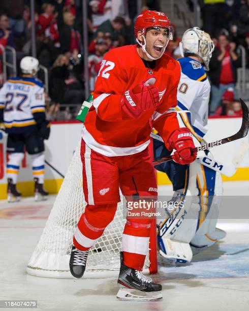 Andreas Athanasiou of the Detroit Red Wings celebrates a third period goal by Dylan Larkin of the Wings during an NHL game against the St Louis Blues...