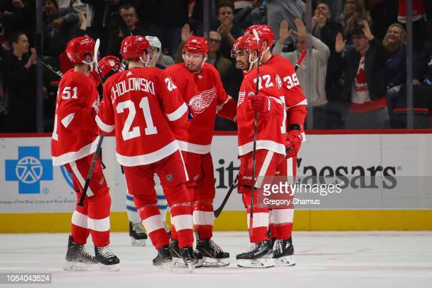Andreas Athanasiou of the Detroit Red Wings celebrates his first period goal with teammates while playing the Winnipeg Jets at Little Caesars Arena...