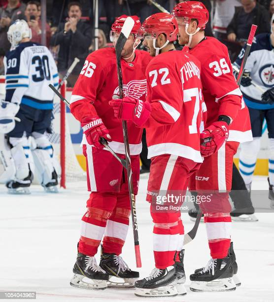 Andreas Athanasiou of the Detroit Red Wings celebrates his first period goal with teammates Thomas Vanek and Anthony Mantha during an NHL game...