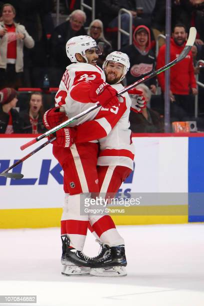 Andreas Athanasiou of the Detroit Red Wings celebrates his game winning overtime goal with Mike Green to defeat the Boston Bruins 32 at Little...