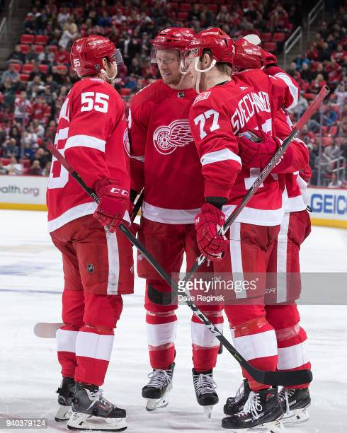 Andreas Athanasiou of the Detroit Red Wings celebrates his third period goal with teammates Niklas Kronwall Anthony Mantha and Evgeny Svechnikov...