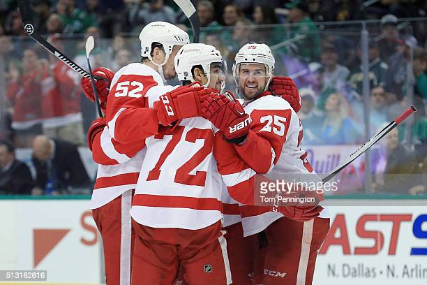 Andreas Athanasiou of the Detroit Red Wings celebrates with Mike Green of the Detroit Red Wings and Jonathan Ericsson of the Detroit Red Wings after...
