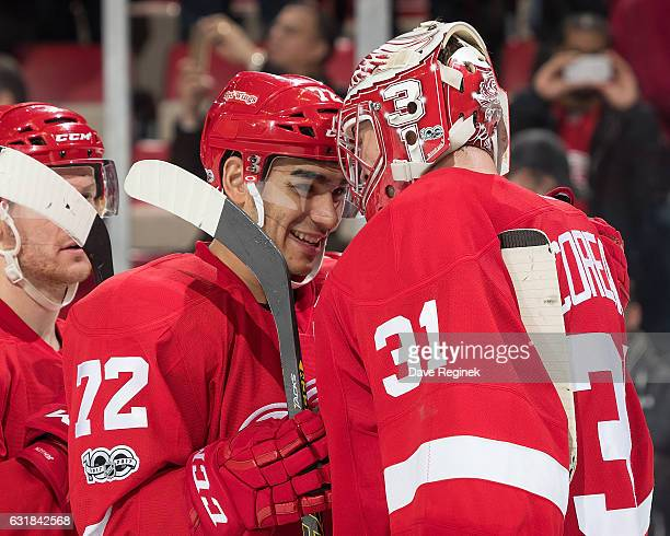 Andreas Athanasiou of the Detroit Red Wings congratulates teammate goaltender Jared Coreau on his shutout following an NHL game against the Montreal...