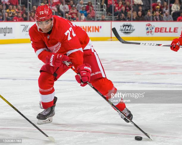 Andreas Athanasiou of the Detroit Red Wings controls the puck against the Boston Bruins during an NHL game at Little Caesars Arena on February 9 2020...